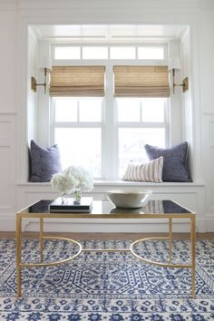 sconces on inside of window seat -- The best white paint colors according to interior designers, Benjamin Moore Simply Whitr Best White Paint, White Paint Colors, White Paints, Br House, Estilo Interior, Woven Wood Shades, Bamboo Roman Shades, Living Room Paint, Living Rooms