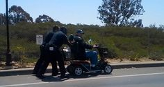 2 San Diego Police Officers Push Disabled Vet 2 Miles Home In His Scooter