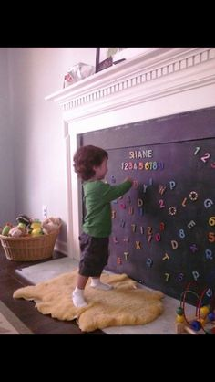 Love this idea! A baby-proof fireplace cover! A magnetic blackboard