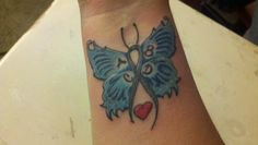 My new tattoo with the gray diabetes ribbon as the body...