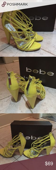 """Bebe multi-strap yellow heels sandals Maggie Popular trendy brand BEBE. Thin leather bands wrap the foot in an amazing, multi-strap heels pumps sandal. Rows of straps arch from the toes to the ankle. Leather lined toe bed. Angled, cone heel. 5"""" heels. Reinforced stitching along each strap. Sandal zips up the back of the heel. Metallic cushioned insole; leather sole. Excellent condition with only noticeable wear on bottoms. Comes with original box showing price $139. Style is called Maggie…"""
