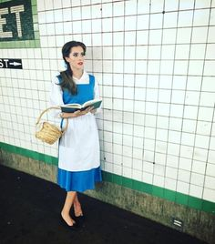 """Allison Williams is pretty much the belle of any ball, so it makes sense that she dressed as Belle from 'Beauty and the Beast' (the beast, in this case, probably being the subway train she was waiting for). """"Ugh Belle I've been telling you to get a damn Kindle,"""" the 'Girls' star wrote alongside this snap. (Instagram)"""