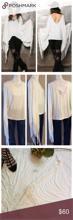 Fringe Poncho Top Über trendy top pale ivory color. Super wide sleeves have long fringe at wrists; tie at back opening customizes fit. Purchased new, but never worn. NWT - excellent condition Tops