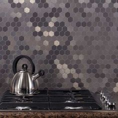 grey shades hexagonal tile splashback