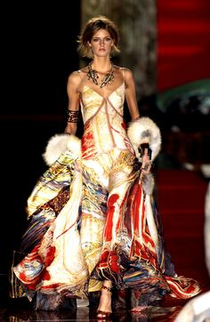 I don't think her body type compliments the dress, but the design is rich and colorful! Roberto Cavalli