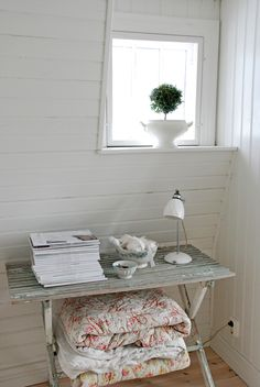 a little desk and a tiny little window