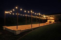 Bocce ball court with lights. Love it!! Have to have it for the backyard.