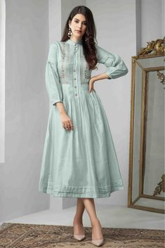 Make the heads flip whenever you dress up in this stunning Baby Blue Color Cotton Slub Readymade Long Kurtis Patterns. the thread work seems to be chic and Designer Kurtis, Designer Wear, Designer Dresses, Silk Kurti Designs, Kurta Designs Women, Blouse Designs, Indian Kurtis Designs, Long Fall Dresses, Casual Dresses