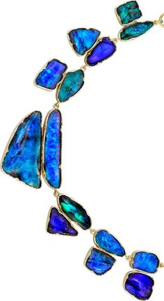 Boulder Opal Necklace One-of-a-kind 18k yellow gold large ovular chain link necklace set with various cuts of boulder opal. 138tcw.