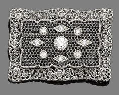 A diamond brooch The pierced rectangular plaque, inset with brilliant-cut diamonds in lozenge and circular collet-settings, within rose-cut diamond scrolling borders. Edwardian or Edwardian style. Edwardian Style, Edwardian Jewelry, Edwardian Fashion, Antique Jewelry, Vintage Jewelry, Fabrege Eggs, Art Nouveau Jewelry, Diamond Brooch, Diamond Are A Girls Best Friend