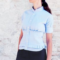 Learn how to turn a man's shirt into this super stylish and feminine office ready shirt in this step by step tutorial.