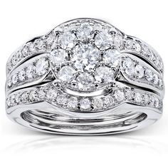 This beautiful bridal ring set is the perfect way to show your commitment. The three-piece set comes with the engagement ring and the wedding rings, so you can purchase the complete ring at one time. The 14-karat white gold ring is stunning.
