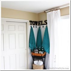 Line a bathroom corner with beadboard, molding, and hooks to make a towel holder that can be wiped down when it gets wet