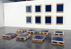 Noel Ivanoff, Stacker P16, 2005, Oil on 16 found pallets. Each panel 920 x 650 x 140mm