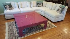 Custom 4-pc sectional sofa by William Alan, Inc., Asian-style lacquer coffee table, oriental style area rug.
