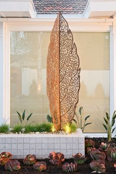Strategically placed sculpture can be both outdoor and indoor focal point creating a stronger connection between living spaces