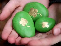 Stones painted with shamrocks make easy garden craft and treasure hunt for St. Patrick's Day.
