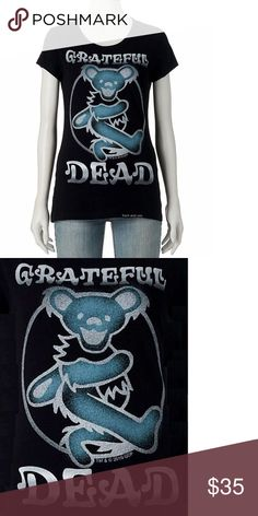 """Grateful Dead Dancig Bear Girls Tee M L XL NWT This black tee features a front screen of the Grateful Dead Dancing Bear Logo on it.  Show your passion for Grateful Dead with this fine T-shirt. 100% Cotton.  Item Condition: New With Tag.  Size  Pit to Pit Neck to Bottom (on the back) M  17""""  25"""" L  18""""  26"""" XL  19""""  26.5"""" Grateful Dead Tops Tees - Short Sleeve"""
