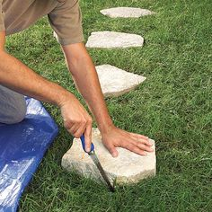 cut grass sections out in the shape of the stepping stone