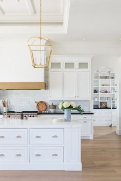 Kitchen Interior Design Kitchen with hood, arched pantry, gold pendants California Traditional Interior Design Farmhouse Style Kitchen, Modern Farmhouse Kitchens, New Kitchen, Home Kitchens, Gold Kitchen, White Ikea Kitchen, Ikea Kitchens, Kitchen Pantry, Ikea Kitchen Design