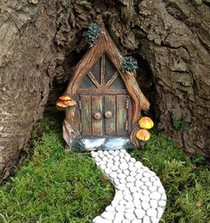 This fairy door with will turn any tree stump in your garden into a whimsical gnome home! The door measures just over wide, and 5 tall. It is made from resin, and will hold up well in your outdoor fairy garden (care should be taken in the winter, you m Fairy Tree Houses, Fairy Garden Houses, Fairy Garden Doors, Fairy Doors, Decoration Shabby, Fairy Furniture, Miniature Furniture, Garden Care, Miniature Fairy Gardens