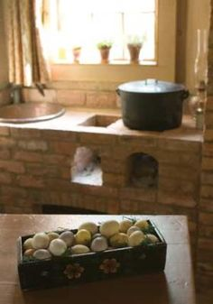 Potager, what the French call a masonry stove fitted with small chambers that hold charcoal for simmering pots.  <3