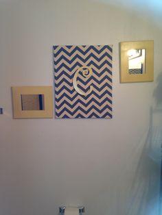 Canvas covered with chevron cloth with hot glue gun. Spray painted mirror frames. Bathroom idea?