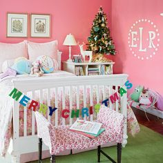 """In this West Palm Beach, Florida, home, the Christmas spirit is infused into every space, including the daughter's happy pink bedroom. A simple """"Merry Christmas"""" banner adds punch, and a miniature tree and reindeer figurine on the bedside table enhance the cheer."""