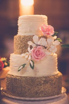 white and sparkling gold wedding cake with pink flowers