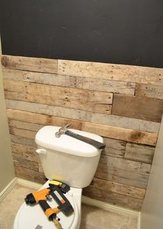 Bathroom Accent Wall- done here in pallett wood. You could even do faux brick. - Bathroom Accent Wall- done here in pallett wood. You could even do faux brick. Bathroom Accent Wall- done here in pallett wood. You could even do faux brick. Pallet Wall Bathroom, Bathroom Accent Wall, Bathroom Accents, Basement Bathroom, Bathroom Ideas, Small Bathroom, Bathroom Cost, Bathroom Flooring, Pallett Wall