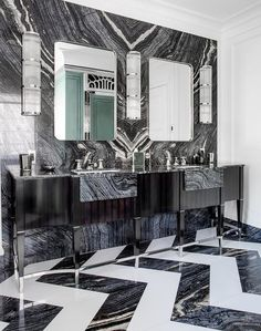 Dramatic black and white bathroom design showcase dual black marble countertop vanity with black marble apron sinks.