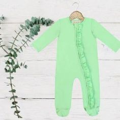 Exclusive Kryssi Kouture - Lime Green Zippie Jumpsuit/Sleeper The sweetest one-pieces for your little one designed by Kryssi Kouture. Our signature one-piece jumpsuit features dainty ruffle details and is easy to change with zip closures. In a gorgeous spring palette, you will find the softest material in the prettiest shade for every little girl's closet.