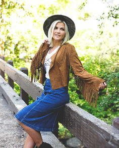 Layer a Faux Suede Fringe Jacket over a graphic t-shirt paired with a denim skirt for the perfect summer to fall transition outfit.