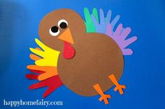Turkey Craft   Happy Home Fairy It would be fun to make a class turkey for the door using all of the kids hand prints.