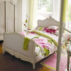 Love this feminine bed...