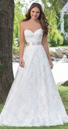 A sweetheart A-line gown with a draped organza bodice bb1cc54e28e4