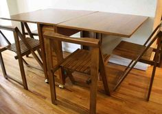 This is a mid century modern gateleg table with 2 folding leaves and all 4 original folding chairs. The table has a tambour door that rolls up to store the chairs. The folding leaves on the table f… Outdoor Furniture Chairs, Dining Room Table Chairs, Dining Room Furniture, Modern Furniture, Furniture Design, Kids Furniture, Foldable Dining Table, Wooden Folding Chairs, Folding Tables