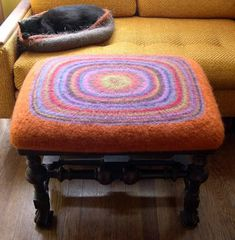Presenting my first use of knitting as a substitute for furniture upholstering: Yes, I did it again. I felted! This was actually knit in t. Felt Cushion, Felt Pillow, Nuno Felting, Needle Felting, Textiles, Diy Ottoman, Art Textile, Felt Decorations, Wool Applique