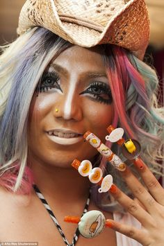 Ganguro is back: Staff at a Tokyo cafe are dressing in bold colours and painting on layers...