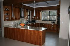 Kitchen - solid kiaat wood with separate scullery and walk-in pantry. AEG gas stove and electric oven Barbeque Pizza, Solid Wood Kitchens, Granite Tops, Electric Oven, Gas Stove, Wood Bars, Walk In Pantry, Kitchenette, Separate