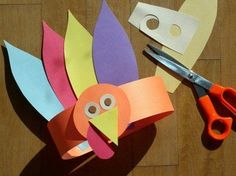 Turkey hats for a Thanksgiving craft. We make these almost every year. You can use feathers instead of paper feathers.