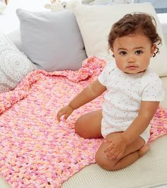 Crochet baby blanket // Pink crochet blanket // DIY baby blanket // Project Courtesy of: Spinrite // Project details on Joann.com
