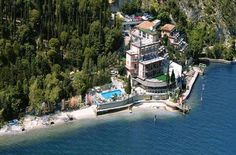 Hotel Capo Reamol - Limone sul Garda ... Garda Lake, Lago di Garda, Gardasee, Lake Garda, Lac de Garde, Gardameer, Gardasøen, Jezioro Garda, Gardské Jezero, אגם גארדה, Озеро Гарда ... Welcome to Hotel Capo Reamol Limone sul Garda, Hotel Capo Reamol is set among cypress and olive trees on the shores of Lake Garda. It offers free parking and air-conditioned rooms with satellite TV, balconies and panoramic views. The Capo Reamol has a restaurant and bar with