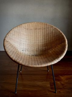 Woven Rattan Chair, Wrought Iron Angled Base, Finished With Plastic Feet.  Circa Offered In Very Good Vintage