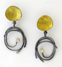 Pebble Scribble Earrings by Sydney Lynch. These earrings are created in oxidized sterling silver and 22k yellow gold, with .5diamond accents.