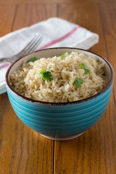 cilantro lime coconut brown rice is an awesome way to jazz but regular brown rice with the addition of lime, cilantro & coconut oil. Make this today!