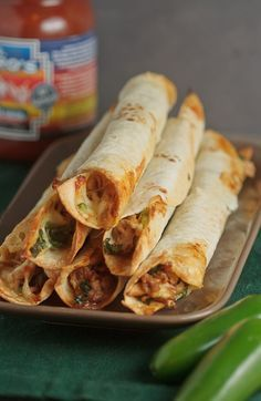 Baked Chicken and Spinach Flautas.  Amazing! Serve with queso and salsa for dipping