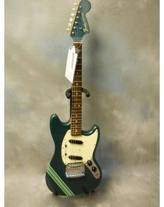 70's Fender Mustang Competition. Dunno if it's Lake Placid Blue with lacquer that has yellowed, or if it's Sherwood Green, but WHO CARES? DAYUM!