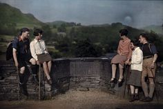 Clifton Adams. 1920s. Hikers rest on Skelwith Bridge, a bourndary line between counties. Skelwith Bridge, Between Westmorland and Lancashire, England.