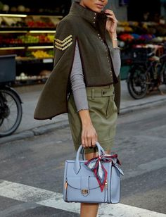 8bb0f55c Poised, polished, and petite, the Bendel Girl carrying the Rivington Mini  Convertible Tote